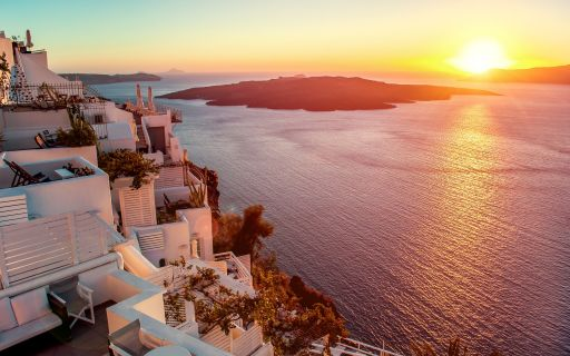 enjoy the stunning sunset in Santorini